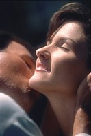 Close_up of a man kissing a woman