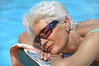 Senior woman relaxing at swimming pool