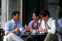 Three men sitting in cafe
