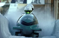 Two people bobsleighing