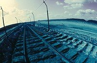 Railroad track passing through landscape