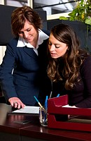 Two women working in office