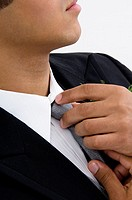Man fixing tie