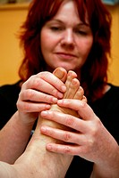 Aromatherapist treating day care service users foot