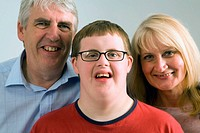 Parents with their teenage son who has Down´s Syndrome,