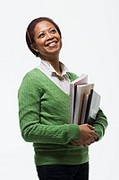 Portrait of teacher holding books (thumbnail)