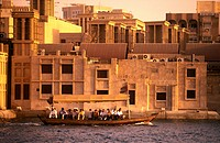 People traveling in boat, Dubai Creek, Bur Dubai, Dubai, United Arab Emirates