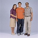 Parents with adult son standing in studio, portrait