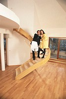 Young couple in new house, man pointing out