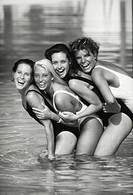 G group of women in swimming pool, laughing (B&W)