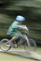 Boy riding bicycle (blurred motion)