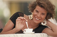 Woman with cup of coffee smiling, portrait