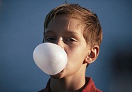 Boy (8-9) blowing bubble gum