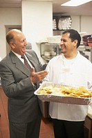 Businessman talking to a chef