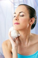 Woman holding body sponge
