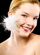 Woman tickling her face with white fur.