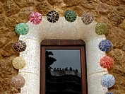 Detail of window with mirror image in the Güell Park by Gaudí, Barcelona. Catalonia, Spain