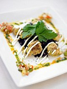 Breaded oysters with cilantro and black beans, elevated view