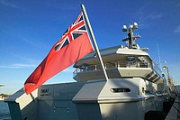 British red ensign flag and luxury yatch in Amaliehaven harbour, Copenhagen. Denmark