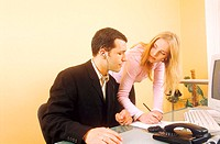 Young business executives working together at a desk