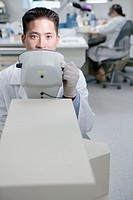 Portrait of male technician in lab with equipment