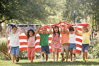 Children running with American flag