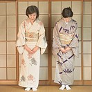 Two Asian women bowing (thumbnail)