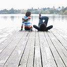 Blurred image of couple on dock
