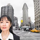Businesswoman standing with cityscape behind her