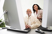 Man and woman reading computer monitor