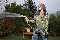 Man spraying water from hose