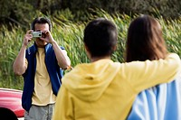 Man taking picture of his family