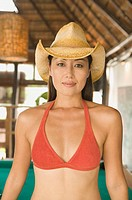 Portrait of woman in bikini top and cowboy hat