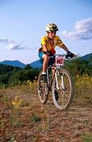 Boy on mountain bicycle in cross-country race.