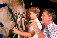 Artist Tom Van Sant and his son Ryan working on the artist´s geosphere project, the first electronic cloud-free mosaic of Earth, compiled from thousan...