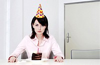 Businesswoman celebrating birthday alone.