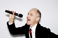 Businessman belting out a song