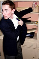 Businessman stealing stationery from his office