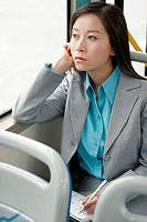Businesswoman writing organizer in the train.