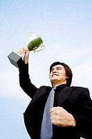 Businessman showing off his trophy