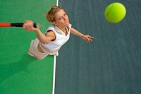 Top View of Female Tennis Player Mid-Serve