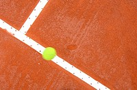 Top View of Tennis Ball Hitting Court Line