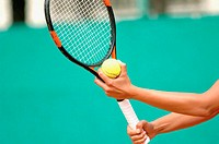 Close-Up of Female Tennis Player Holding Ball Serve
