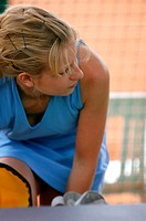Female Tennis Player Resting By Court
