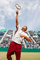Front View of Male Tennis Player Serving