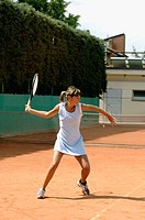 Side View of Female Tennis Player