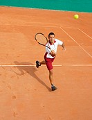 Male Tennis Player Running for Ball