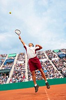 Male Tennis Player Jumping For Ball