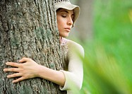 Woman hugging tree