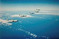 C-130 Hercules cargo planes flying in formation